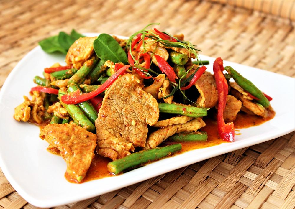 Thai Red Curry Pork Stir Fry on a white plate