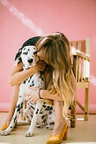woman-hugging-dalmatian-dog-2053921.jpg