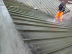 Pressure washing metal roof