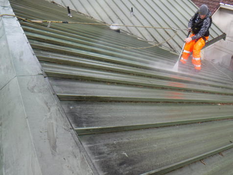 Pressure washing metal roof