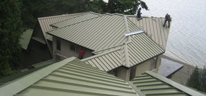 Home on lake with example of metal roofing.