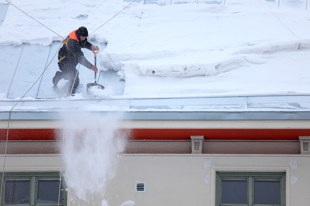 Safely removing snow from roof.