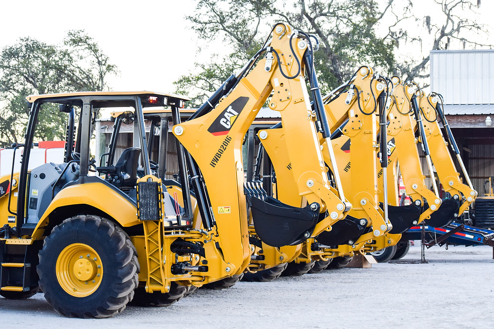 Brand new CAT backhoes that will be used for directional drilling in the Tampa Bay Area.