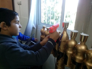 Fifth graders enjoy making Chanukah menorahs from recyclable materials