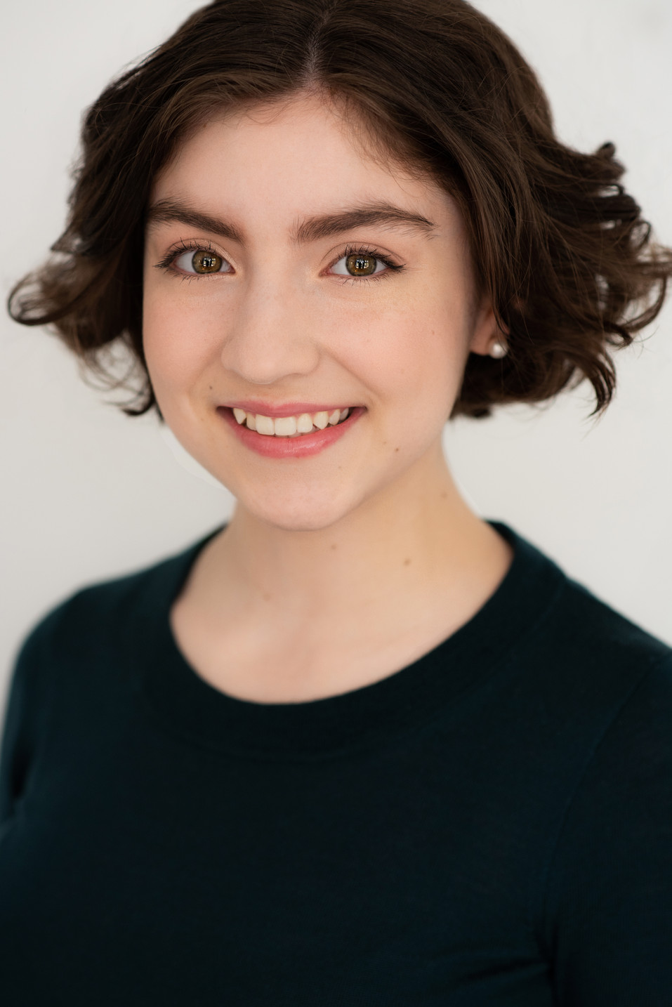 A teenage actress with a great smiling headshot.