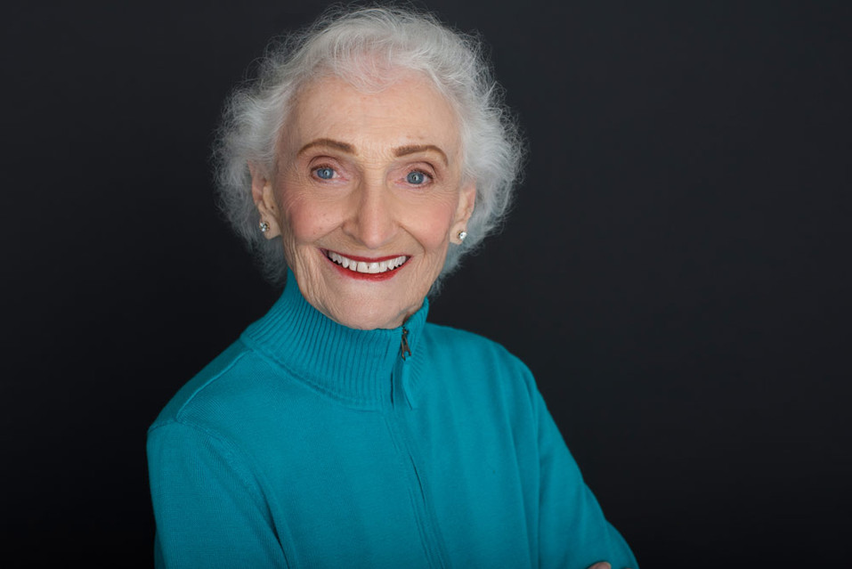 A headshot of an older woman with stunning eyes.
