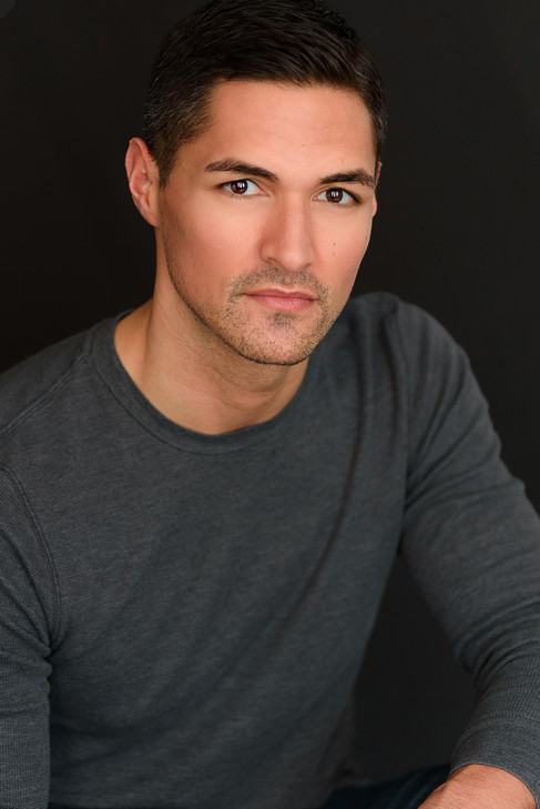 Stunning headshot of a handsome man looking intently at the camera.