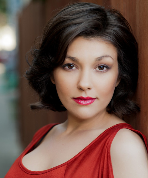Gorgeous headshot of an actress wearing red.