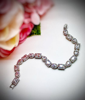 Multishape CZ bracelet, with alternating ovals, rectangles, & pears with halos