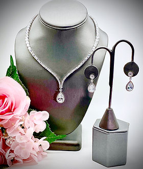 Graduated CZ graceful curved necklace set with large pear drop with halos