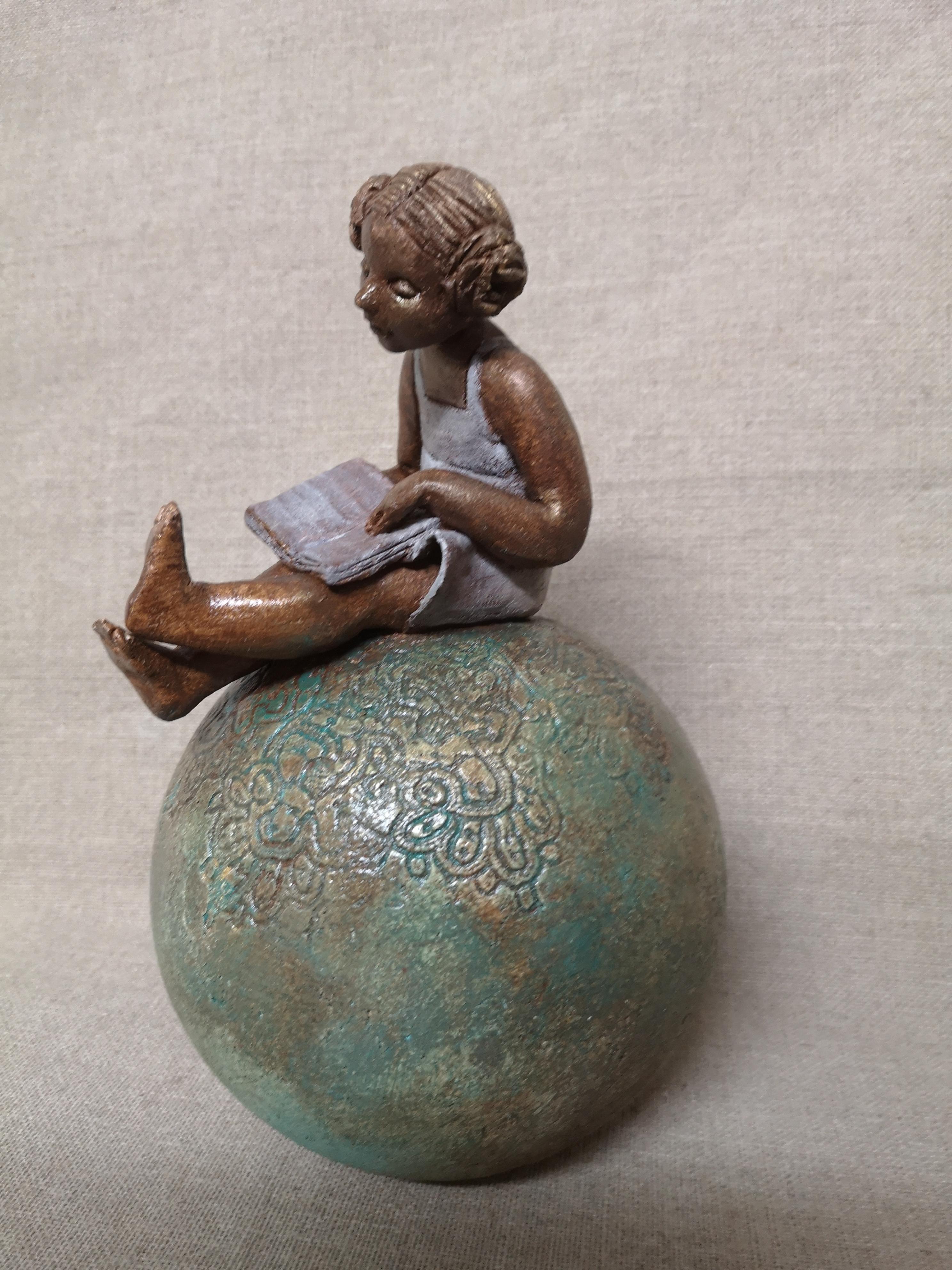 petite liseuse  sur boule patine bronze.