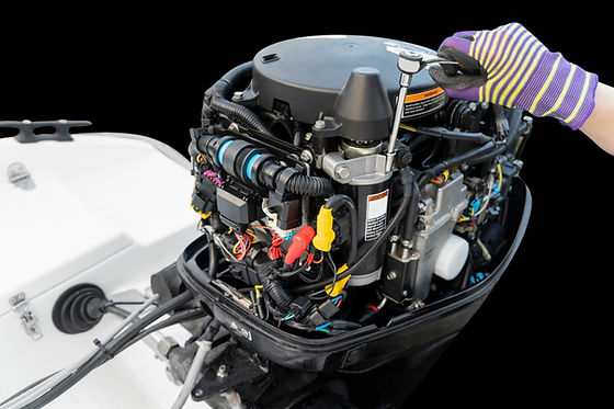 Repairing  outboard marine engine. Motor