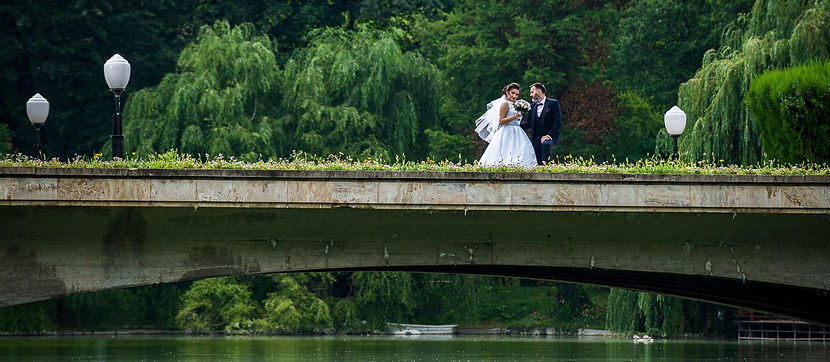 Bride and groom on a bridge at the lake at wedding day!