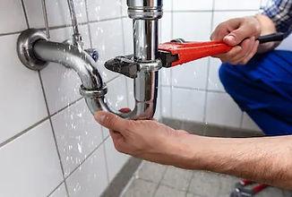 male-plumbers-hand-repairing-sink-260nw-1149190532_edited.jpg