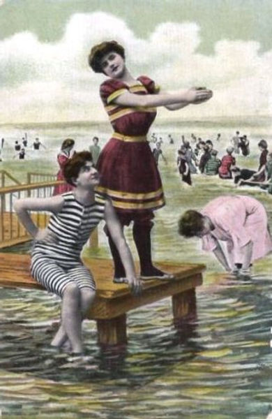 Bathers take to the waters almost fully clothed.