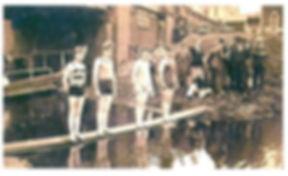 Members of Stroud Swimming Club prepare to dive at the Upper Lock, Wallbridge