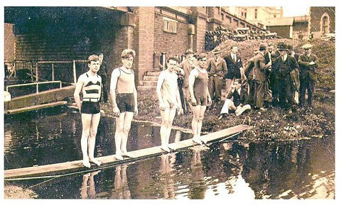 Members of Stroud Swimming Club prepare to dive at the Upper Lock, Wallbridge