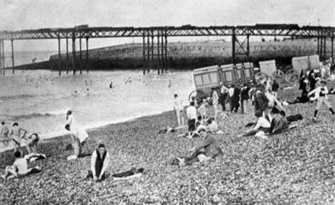 Boys Swimming from the beach at Brighton