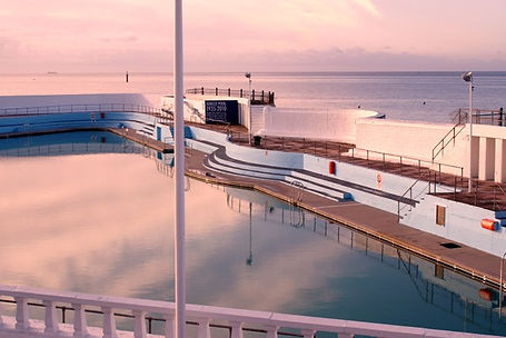 Penzance Lido - Jubilee Pool - with the wild swimmers bathing place just beyond it.