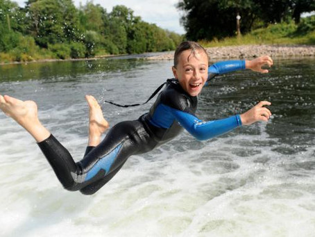 Al fresco dips teach children to swim safely