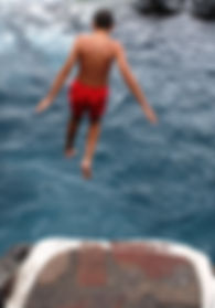 Teenager jumps into the sea, wild swimming Tenerife