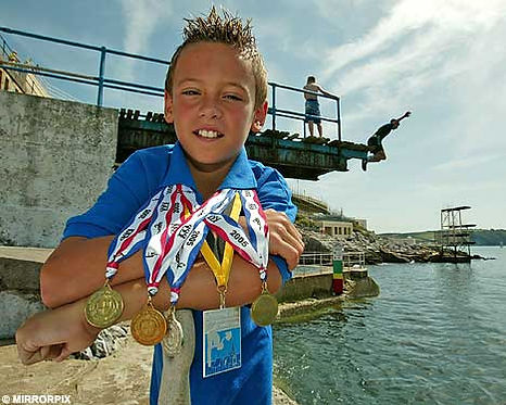 Tom Daily beside the diving boards that inspired his career