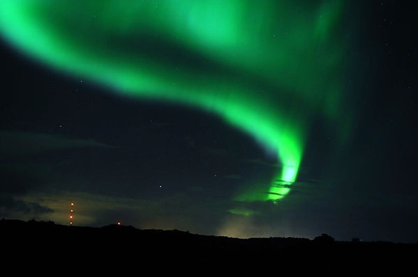 Wild Swimming with the Northern Lights in Iceland