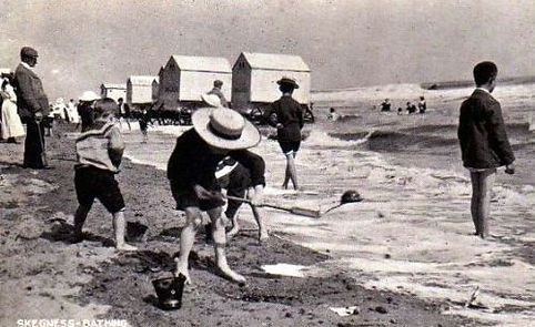 Bathers on the beach at Skegness. Bating Machines History