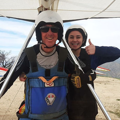 Andy and a happy student prepare to launch a tandem hang glider