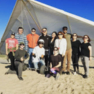 Big happy hang gliding family had a blas