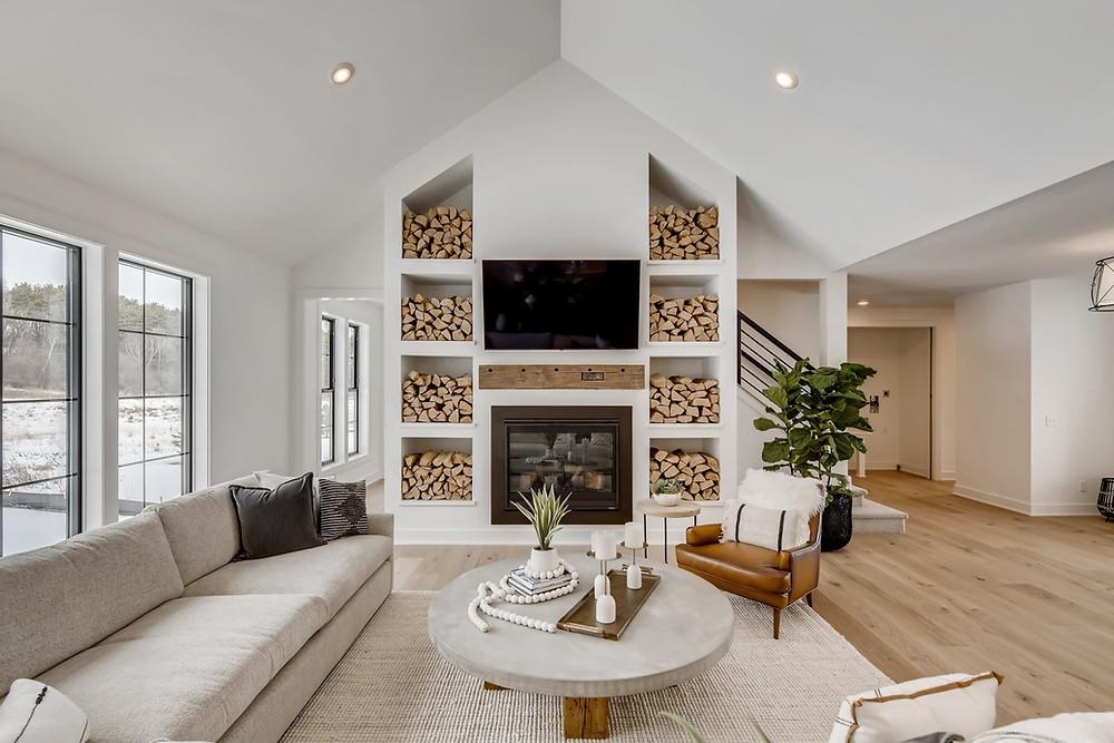 built-in firewood storage, vaulted ceilings, rustic mantle