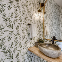 Pantry bathroom with wall paper