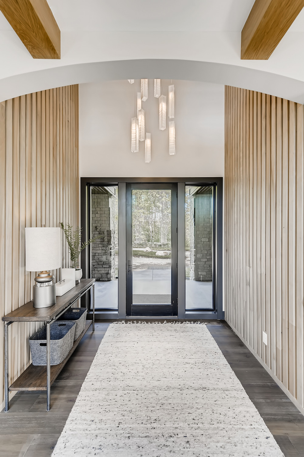Wood slat feature wall, front entry, beams