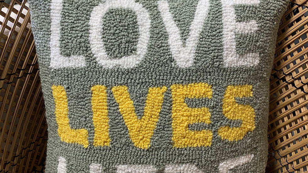 Needlepoint Love Lives Here pillow in gray and yellow hues