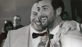 Just married laughing grooms