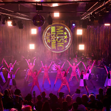 Vision Dance Co's dancers performing on stage at a corporate event