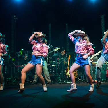 Vision Dance Co's Cowboy and Cowgirl dancers performing at a corporate entertainment event