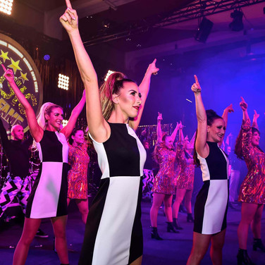 Vision Dance Co's dancing ladies performing on stage at a corporate event