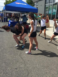 Natalie Boegel, Victoria Rufolo, and Elizabeth Shew improvising with NWDP at a street fair in Portland, OR