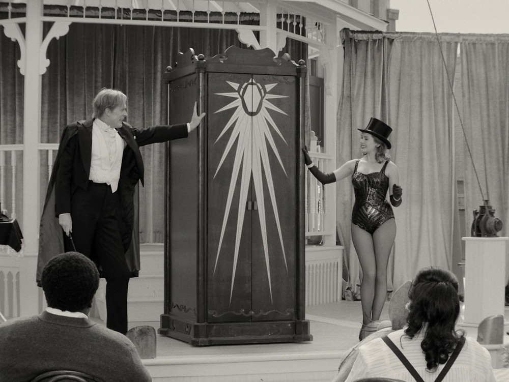 Wanda and Vision and the cabinet of mystery at the talent show.