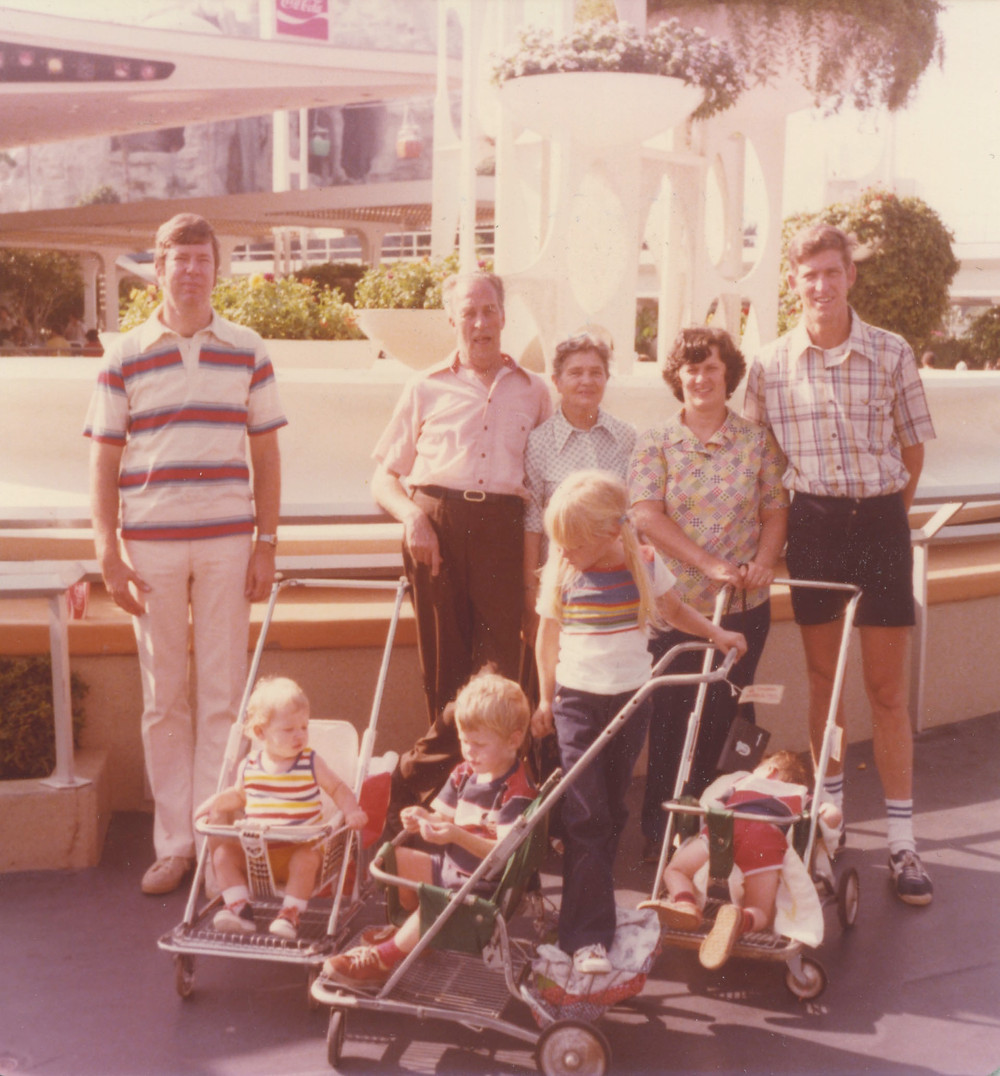 The Flint Family Annual Spring Break Trip to Disneyland. Colleen is the one standing on the stroller and Ryan is the baby face down in the stroller.