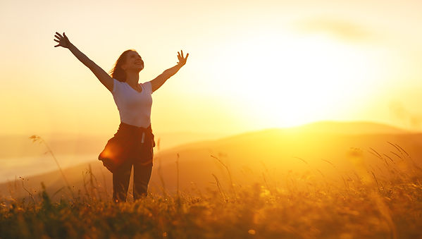 Happy woman   on the sunset in nature in