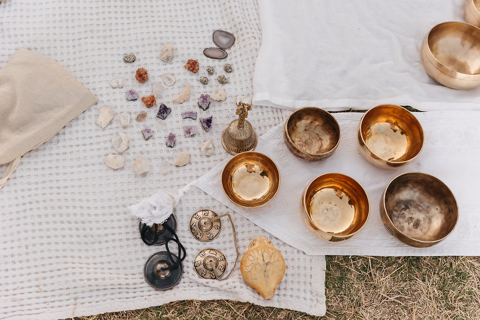 singing bowls, beautiful stones on a bei
