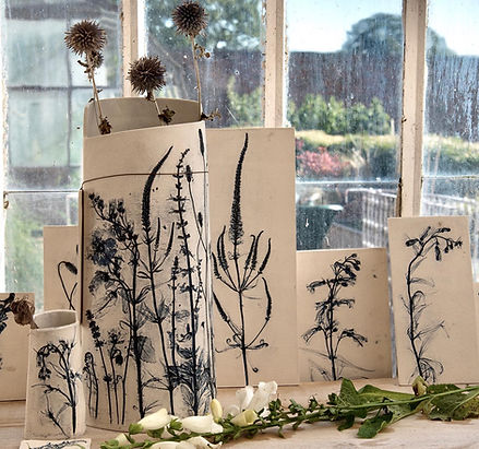 Garden flowers preserved in vases and tiles.