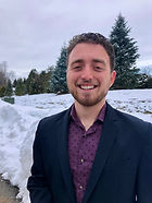 Program Coordinator, Joshua Singer. Standing outside, with a snowy background