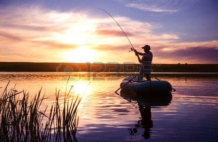 31259739-mature-man-fishing-from-the-boat-on-the-pond-at-sunset