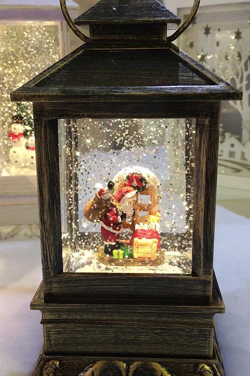 KS008 Bronzed Effect Water Filled Lantern. Santa leaving presents