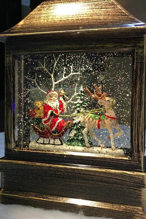 KS002  Water Filled Lantern.Santa on his Sleigh with a Reindeer