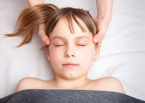 Elementary age girl's head being manipul