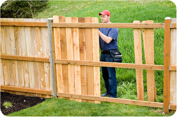 "<img src=""PineWoodFence.jpeg"" alt=""Buildinmg pressure treated fence in Katy TX"">"